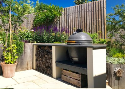 traditional landscape design with a barbecue in Kent
